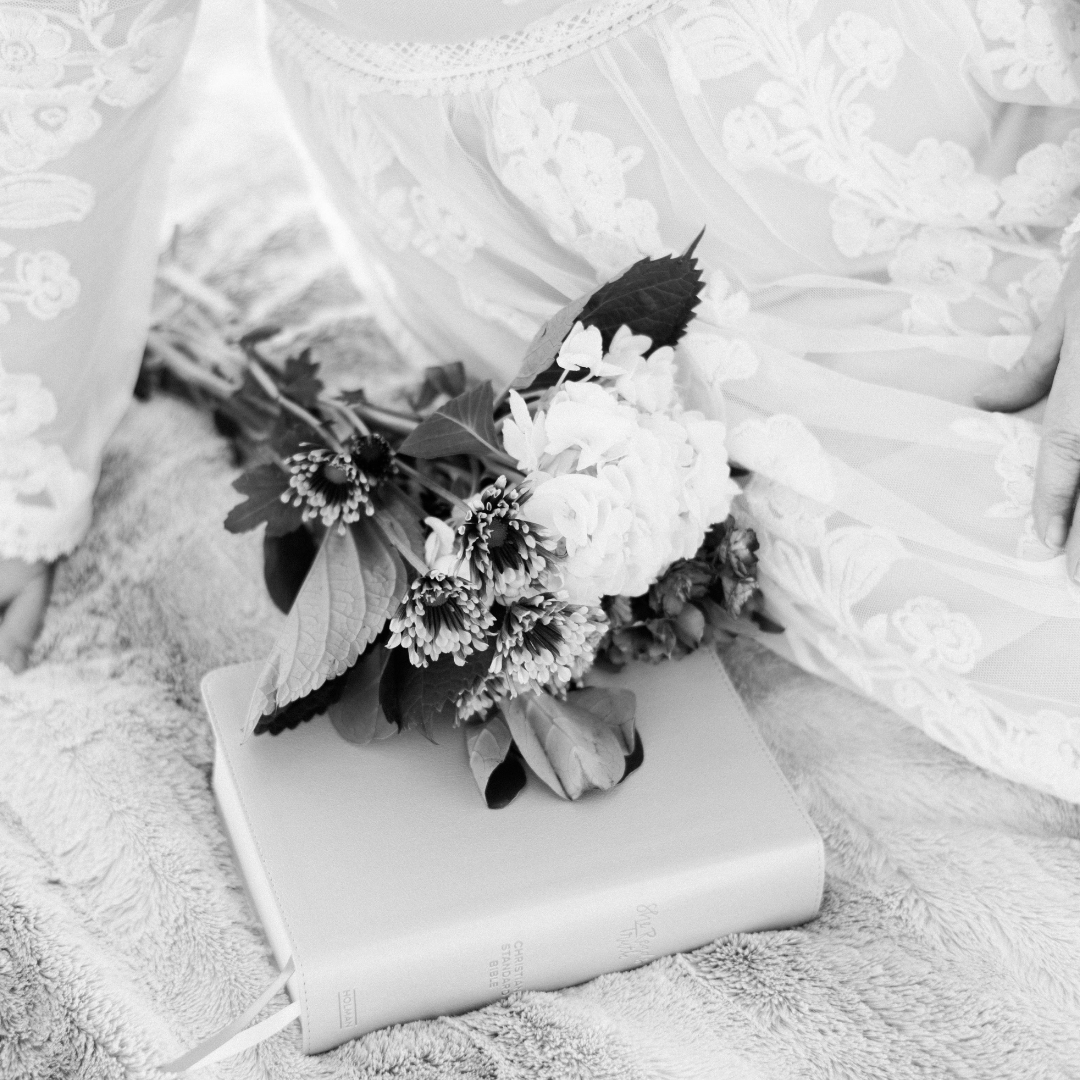 flowers on a bible on a blanket